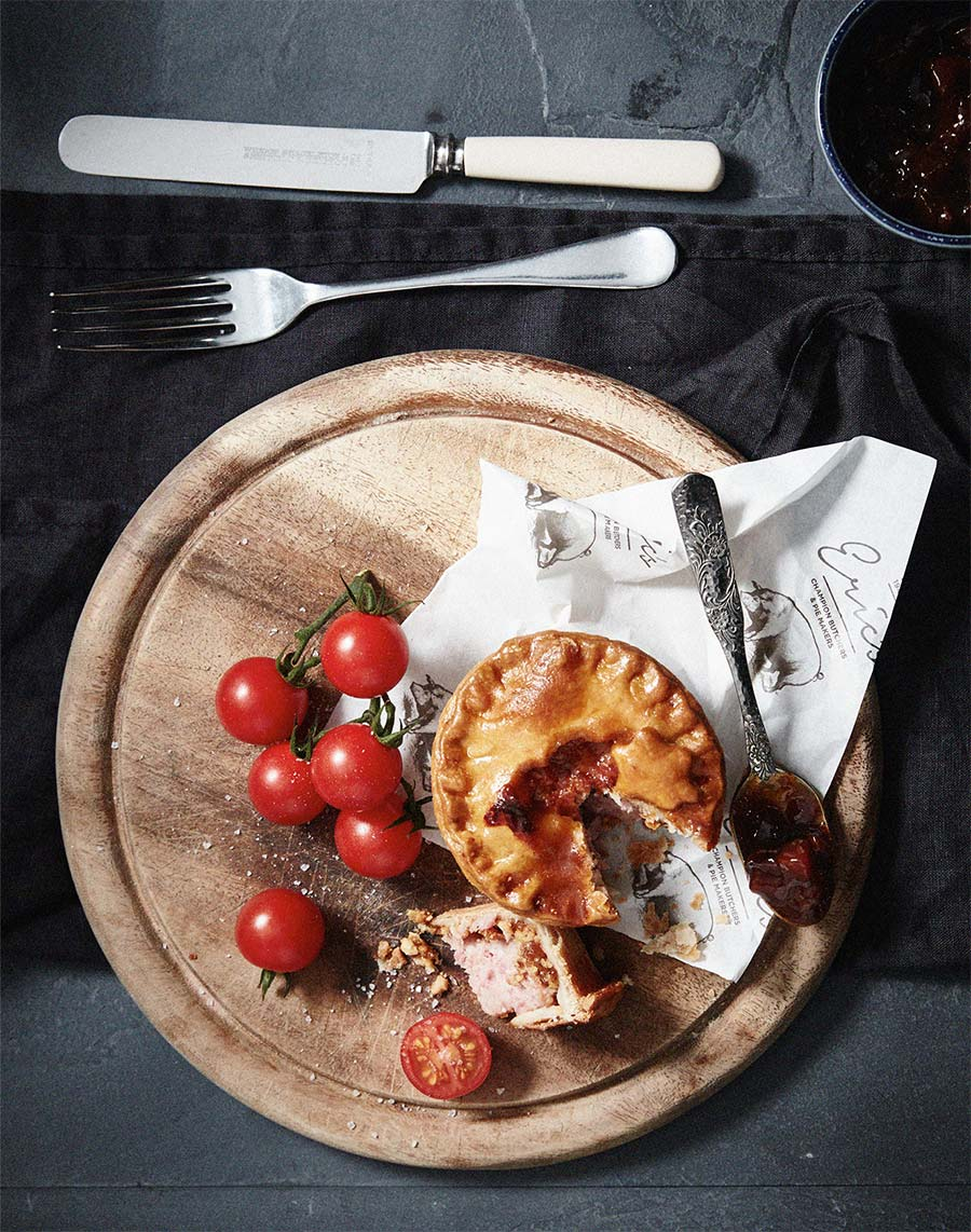 Pies & Tomatoes on Chopping Board